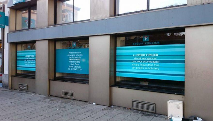 Habillage vitrine d'une banque en impression numérique
